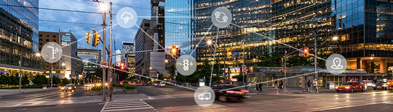 A cityscape with overlays that emphasize interconnectivity. The Internet of Things (IoT) and M2M at Rogers—from IoT connectivity to consultation and turn-key solutions, learn about our LTE, LTE-M, NB-IoT, Fleet, Asset and Smart City services, partners and solutions.