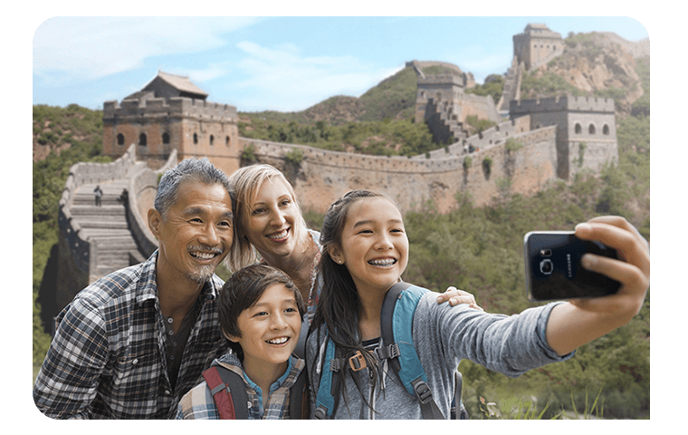 Family taking photo at the great wall of China