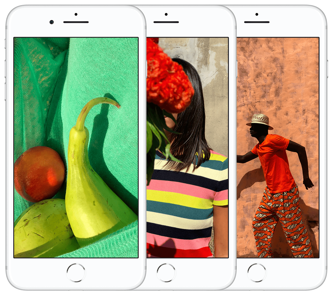 Three iPhone 8s, one displays a red image, another a blue and the last a green image