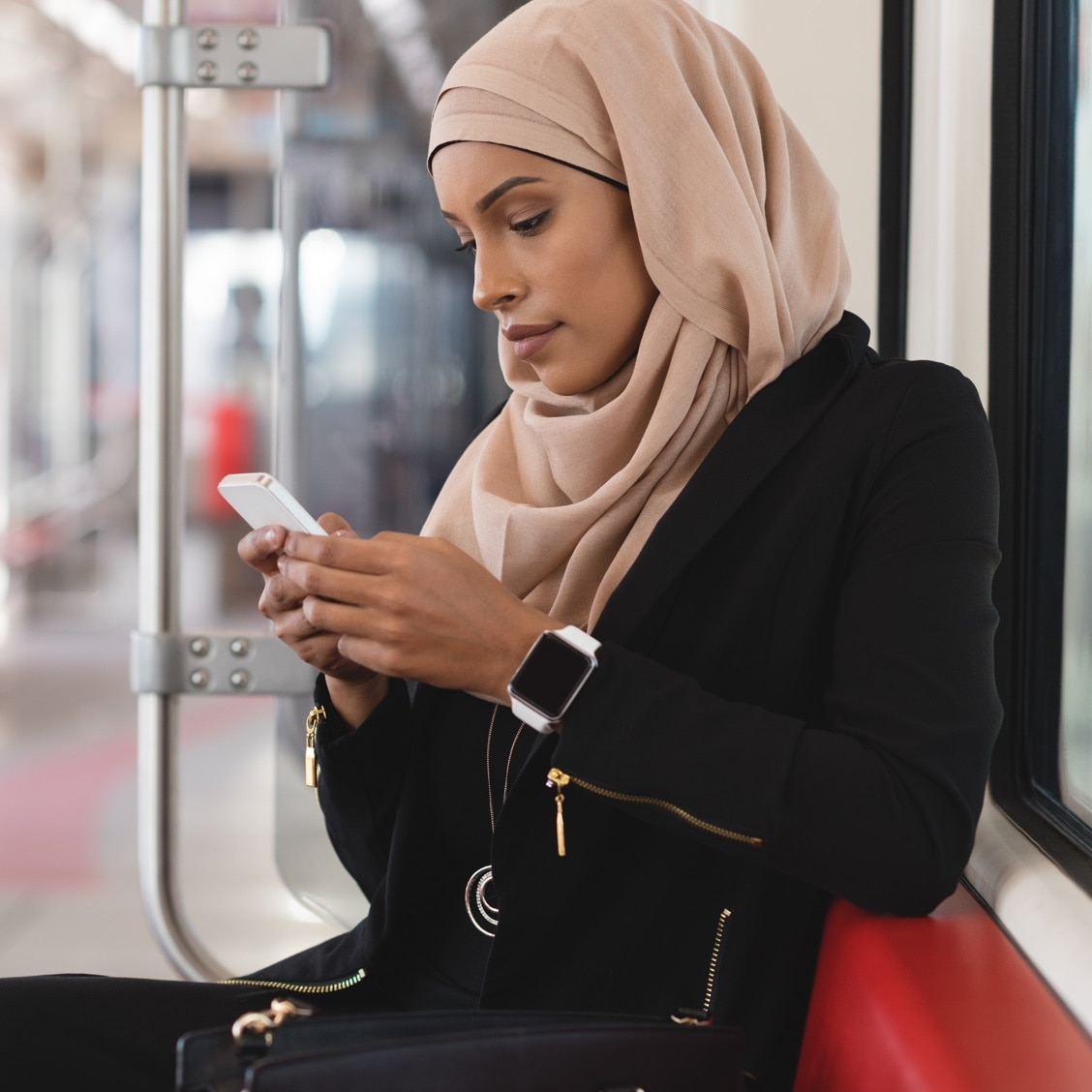 A woman using mobile data while on public transit.