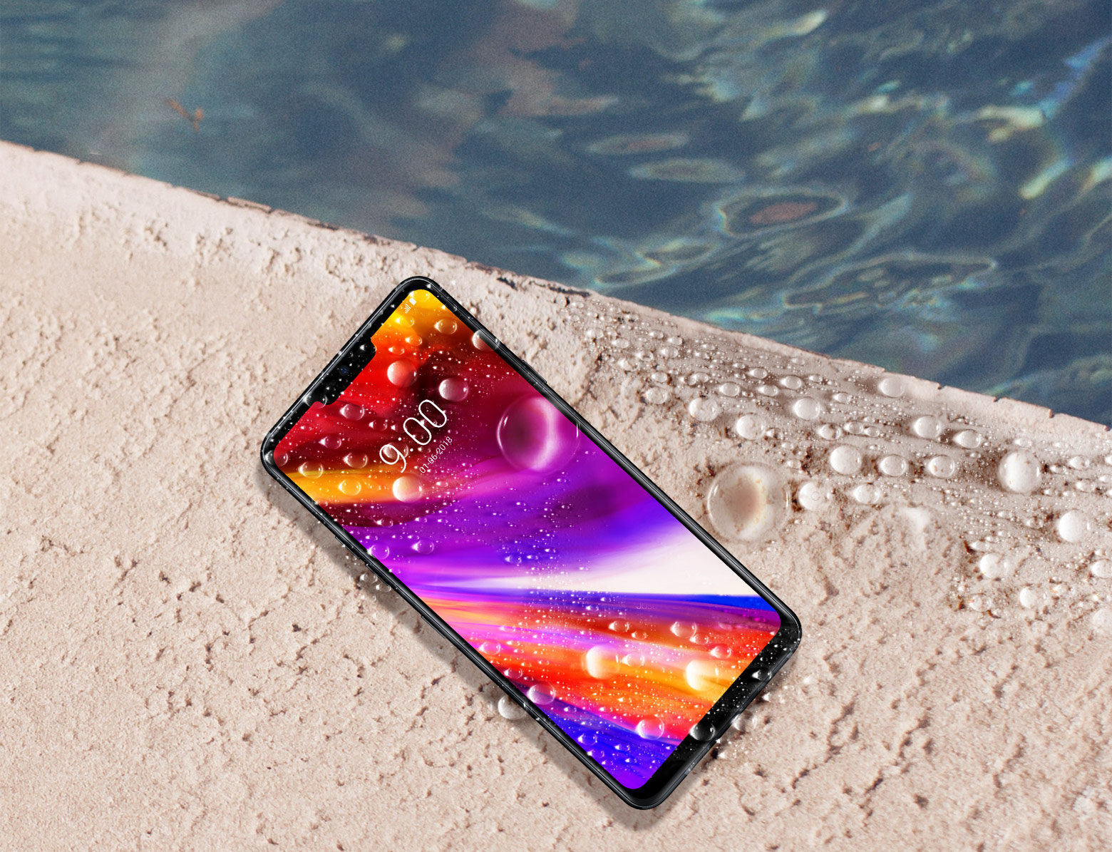 An LG G7 ThinQ lies by the side of a pool covered in water droplets to showcase its water resistance.
