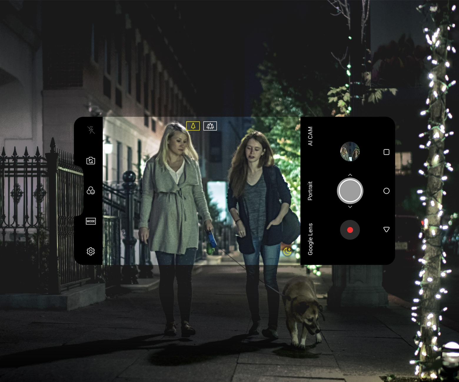 Capturing photo of two women walking a dog in the dark.